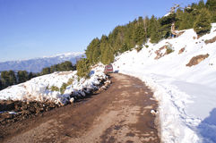 A narrow track through the snow covered mountains Royalty Free Stock Photography