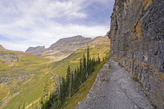 Narrow Trail Along a Steep Cliff Wall in the Mountain Royalty Free Stock Photo