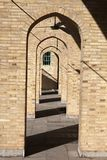 Narrow vaulted passage of clay brick in mosque, Yazd, Iran. Narrow archway from mud brick in the territory of one of the mosques of Yazd in Iran Stock Photos