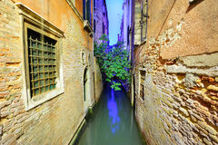 Narrow Venetian canal Royalty Free Stock Image