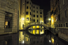 Narrow Venetian canal at night in Venice, Italy. Stock Photography