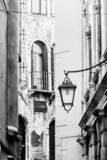 Narrow venetian street, traditional italian architecture. Venice, Italy, Europe. Black and white image