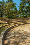 Narrow view of circular concrete steps in a green garden, Chennai, India, April 01 2017 Stock Images