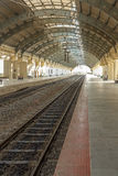 Narrow view of a locomotive electric train station platform with covered tunnel, Chennai, India, Mar 29 2017 Stock Photo