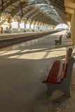 Narrow view of a locomotive electric train station platform with unoccupied seat and covered tunnel, Chennai, India, Mar 29 2017 Royalty Free Stock Photography