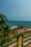 Narrow view of seashore with wooden fence in the foreground from viewpoint,Kailashgiri,Visakhapatnam,AndhraPradesh,March 05 2017 Stock Photo