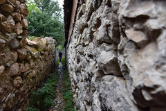 Narrow village alley with stone walls Royalty Free Stock Image