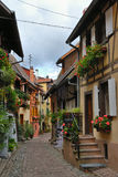 Narrow village street Stock Images