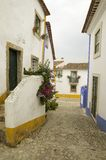 Narrow village streets of Obidos founded by the Celts in 300 BC, Portugal Stock Photography