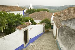 Narrow village streets of Obidos founded by the Celts in 300 BC, Portugal Royalty Free Stock Photos