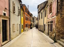 A narrow walking street of old touristic town. Skradin in Croatian Mediterranean Coast stock photo