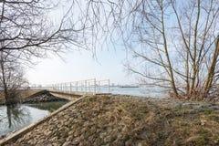 Narrow walkway across the water Stock Images