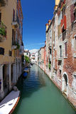 Narrow water canal in Venice Stock Image
