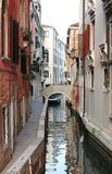 narrow water way in Venice Italy stock photos