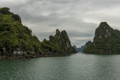 A Narrow Waterway at Low Tide. Narrow Waterway through Ha Long Bay Rock Formations at low tide Royalty Free Stock Photos