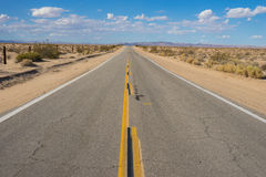 Narrow Western Desert Road Stock Image