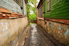Narrow wet street between old houses at Vladimir city, Russia Stock Photos