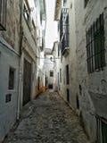 Narrow white street stock photo