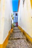 Narrow White Yellow Street Medieval City Obidos Portugal. Narrow White Yellow Street 11th Century Medieval Town Obidos Portugal Royalty Free Stock Photography