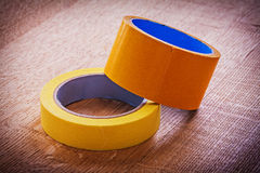 Narrow and wide duct tapes on vintage brown wooden Stock Image