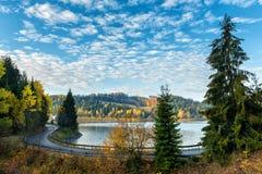 Narrow winding road along the lake, autumn landscape Royalty Free Stock Photography