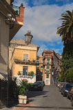 Narrow winding streets of the city. A large number of parked cars occupied almost the entire carriageway Royalty Free Stock Photos