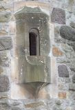 Narrow window in old fortress Royalty Free Stock Photography