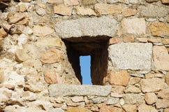 Narrow windows on a medieval wall Royalty Free Stock Photo