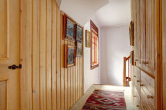 Narrow wood plank paneled hallway Royalty Free Stock Image