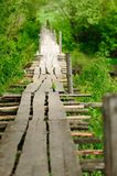 Narrow wooden bridge in spring Royalty Free Stock Images