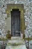 Narrow wooden door on English church. Stock Photo