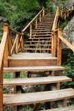 Narrow wooden path suspended over rocks Stock Photography
