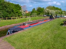 Narrowboat in canal lock. Narrowboat in a canal lock in the lower position befor flooding the lock chamber. Picture taken on the Shropshire Union Canal near Royalty Free Stock Image
