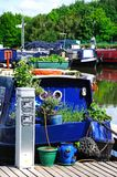 Narrowboat connected to electricity supply. Stock Images