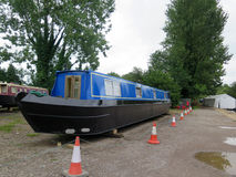 Narrowboat in Dry Dock. Un-named blue Narrowboat in Dry Dock on banks of Kennet and Avon Canal in Hampshire, England Stock Photography