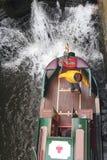 Narrowboat in lock. Pleasure craft navigating lock Royalty Free Stock Images