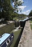 Narrowboat passing through a lock at Devizes UK Stock Photos