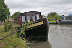 Narrowboat tied up at a Towpath. Royalty Free Stock Image