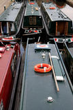 Narrowboats moored on Canal. Narrowboat or narrow boat is a boat of a distinctive design, made to fit the narrow canals of England and Wales Stock Images