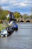 Narrowboats, River Severn, Tewkesbury, Gloucestershire, UK. Narrowboats and bridge over the River Severn in Tewkesbury, Gloucestershire, England Royalty Free Stock Photo