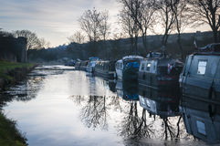 Narrowboats. A winter image of Narrowboats moored on the Leeds and Liverpool canal at Barnoldswick in lancashire, England Royalty Free Stock Photography