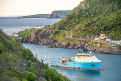 The Narrows leading to port in St. John`s, Newfoundland, Canada. Fishing boat heading the port in St. John`s, Newfoundland and Labrador, Canada Stock Photography