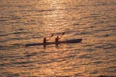 nart Paddlers oceanu słońca odbicia  Zdjęcie Royalty Free