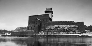 Narva castle. View of Herman Castle with reflection on the water in black and white Royalty Free Stock Photography