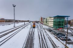 Free NARVA, ESTONIA - FEBRUARY 23, 2017: The Cargo Train Wich Consists Of Diesellocomotive And Many Wagons Is Waiting The Royalty Free Stock Images - 112779739