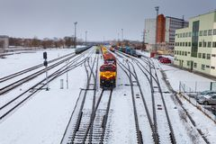 Free NARVA, ESTONIA - FEBRUARY 23, 2017: The Cargo Train Wich Consists Of Diesellocomotive And Many Wagons Is Waiting The Royalty Free Stock Image - 112779796