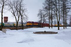 Free NARVA, ESTONIA - FEBRUARY 23, 2017: The Cargo Train Wich Consists Of Diesellocomotive And Many Wagons Is Waiting The Stock Photo - 112779800