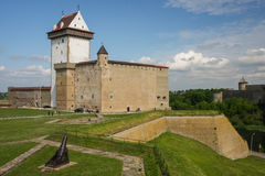 Narva, Estonia. Medieval castle of Narva standing opposite of fortress of Ivangorod Stock Photography