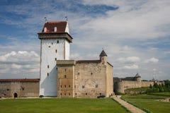 Narva, Estonia. Medieval castle of Narva standing opposite of fortress of Ivangorod Stock Photo