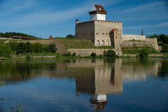 Narva Herman Castle. City of Narva, Estonia. View of Herman Castle with colorful reflection of lights off the water royalty free stock images